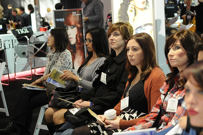 Beauty professionals watching the TIGI demonstration