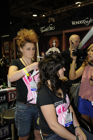 Innovative styling at the Doll Haircare booth - ISSE Long Beach 2012
