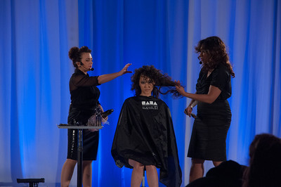Hairstylist and educator, Faatemah Ampey at ISSE Long Beach 2013 in the NAHA Theater presenting her signature cutting and styling class