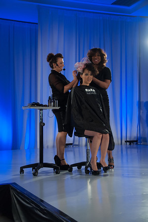 Hairstylist and educator, Faatemah Ampey at ISSE Long Beach 2013 in the NAHA Theater presenting her signature cutting and styling class.