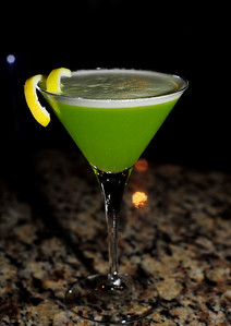 Green Tea ÍStini Ingredients: 0.5 oz. ÍS Vodka 1.5 oz. Cooled Green Tea 0.5 tsp Honey Squeeze of Lemon Lemon Twist for Garnish  Photograph by Mark Bowers for iS Vodka Shot at Nora's, 6020 W Flamingo Rd