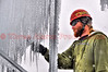 A worker harvesting icicles to be added to the main ice structures.