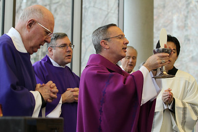 Holding the body and blood of Christ, Bishop Luis Zarama leads the Great Amen during the 50th anniversary Mass for Ignatius House Retreat Center, Atlanta.