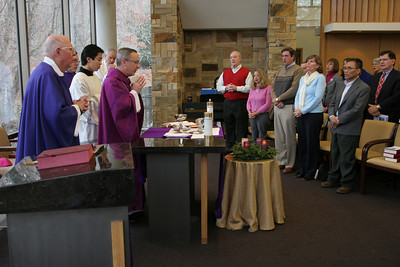 Bishop Luis Zarama, second from left, the main celebrant and homilist for the Dec. 18 Mass marking the 50th anniversary of Ignatius House, Atlanta, leads the congregation in prayer during the Liturgy of the Eucharist.