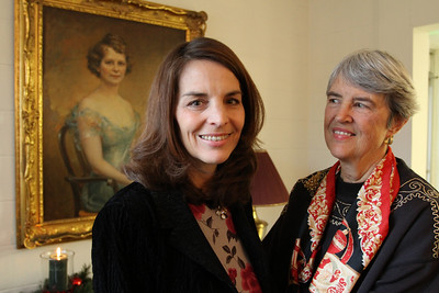 Suzanne Cronk Jeffers, left, the first great-grandchild of Suzanne Spalding Schroder, and Jeffer's mother Suzanne Schroder Cronk stand in front of a portrait of the elder Schroder. Jeffers was born on the same day Ignatius House was dedicated 50 years ago, Dec. 18, 1960.