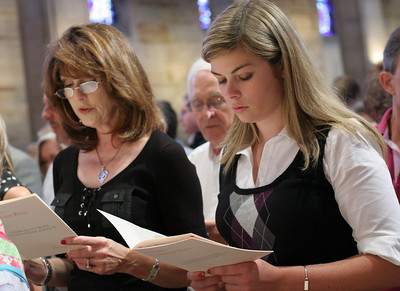 Jeanne Ann Beckwith of Peachtree Road United Methodist Church, Atlanta, and Carlin Dwyer of Holy Spirit Church, Atlanta, sing the closing hymn of the Good Friday meditation service on The Seven Last Words of Christ.