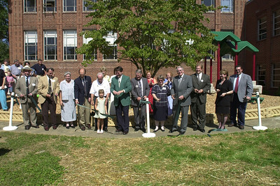 "James H. ""Buck"" Harless, 5th from left, participates in the ribbon cutting for the June Harless Center for Rural Educational Research and Development in 2001."