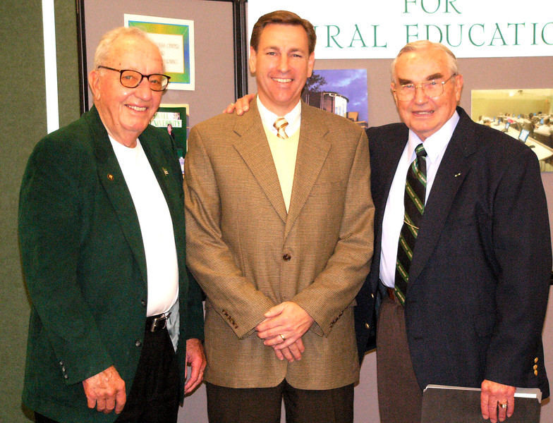 """James H. """"Buck"""" Harless, left, poses with Sen. Robert Plymale and Dr. Sam Clagg at the 2004 induction ceremony for the June Harless Center for Rural Educational Research and Development Hall of Fame."""