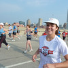 Liz has an easy smile on our way up the Hoan Bridge, southbound<br /> July 10, 2011, Summerfest Half Marathon<br /> We carried our own water & fluids, which was good, since the aid stations on the bridge ran out of cups & water