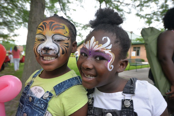 Face painted children at picnic.