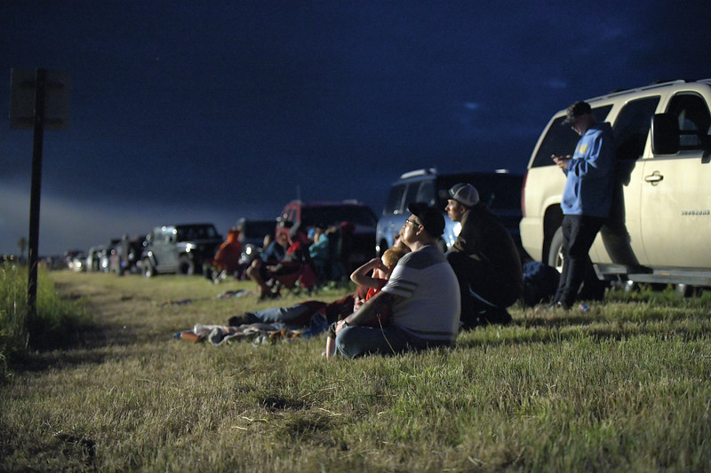 Matthew Gaston | The Sheridan Press<br>Families watch the fireworks show from the grass along the side of the road in Ranchester Thursday, July 4, 2019.