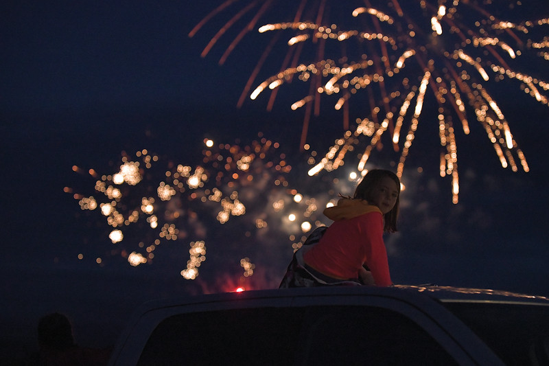 Matthew Gaston | The Sheridan Press<br>A little girl turns her head to listen for the echo of the fireworks in Ranshester Thursday, July 4, 2019.
