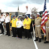 Diane Raver | The Herald-Tribune<br /> Batesville Veterans of Foreign Wars color guard members (from left); three of Batesville's torch bearers, Mike Fristch, representing the Eureka Band, Jon Kuntz and Dave Johnston; and Prell-Bland American Legion color guard members listen as Mayor Mike Bettice talks.