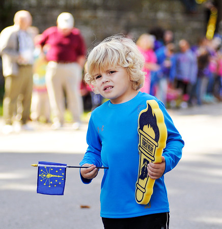 John P. Cleary   The Herald Bulletin<br /> Colton Ulm, 4, anxiously waits for the Indiana Bicentennial Torch Relay to show up in Falls Park.
