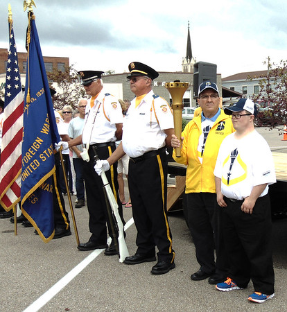 Diane Raver | The Herald-Tribune<br /> Torch bearers Jon Kuntz (from right) and Mike Fritsch and Batesville Veterans of Foreign Wars color guard members participated in activities downtown.