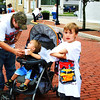 Debbie Blank | The Herald-Tribune<br /> Todd Smithson-Cox (in cap), Osgood, and sons (from left) Jackson, 9, Kolsyn, 1, Daultyn, 6, and Cadyn, 10, enjoy the town festivities. They wear free Osgood 150th T-shirts that were distributed at the museum there.