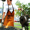 Debbie Blank | The Herald-Tribune<br /> Apprentice blacksmith Corran Smith makes a troll cross, a Viking symbol to ward off evil, at the Versailles gathering.