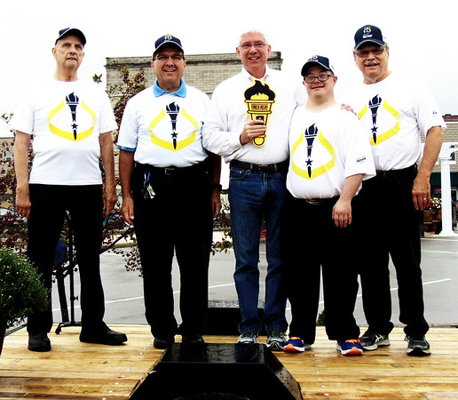 "Diane Raver | The Herald-Tribune<br /> Mayor Mike Bettice (center) recognizes Batesville's torch bearers (from left) Thomas ""Ace"" Moorman, Mike Fritsch (representing the Eureka Band), Jon Kuntz and Dave Johnston."