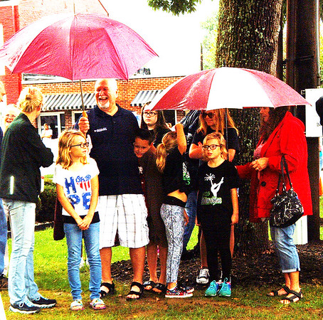Debbie Blank | The Herald-Tribune<br /> A downpour let up just before the Indiana Bicentennial Torch Relay arrived in Versailles.