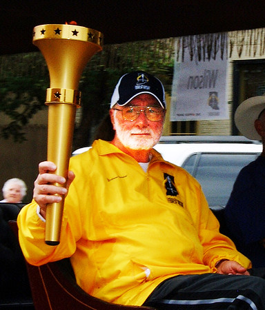 Debbie Blank | The Herald-Tribune<br /> After Katherine Taul and Carla Stenger, Jerry Wilson was the third Ripley County torchbearer, arriving in Versailles.