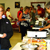 Debbie Blank | The Herald-Tribune<br /> Many of the 200 attendees at the Milan Veterans of Foreign Wars Hall evening gathering took advantage of a chicken dinner. Here auxiliary member Bea McMillan (right) serves Jane Richie, Milan.