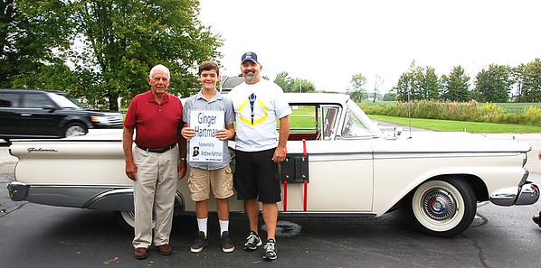 Photo courtesy of Carla Hacker<br /> The late Ginger Hartman was named a Sunman torchbearer. Her son, Andrew (right), carried the torch in her memory. With him are dad Donald (left) and son Wyatt.