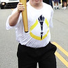 Diane Raver | The Herald-Tribune<br /> Jon Kuntz carries the torch down Pearl Street.