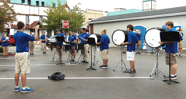 Diane Raver | The Herald-Tribune<br /> The Batesville High School Bulldog Brigade Band performed songs downtown.