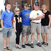 Diane Raver | The Herald-Tribune<br /> Torch bearer Jeff Paul, holding grandson Brody, is surrounded by (from right) wife Ellen, son Ryan, daughter-in-law Tina and son Jacob.