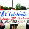 "Debbie Blank | The Herald-Tribune<br /> A sign carried by Dan Shepherd (left), New York, and Steve Pruss, Chicago, celebrates the Milan High School 50th reunion. Earlier, attendees gathered at the town memorial for a classmate, Col. ""Buddy"" Boone, who perished Sept. 11, 2001, at the Pentagon."