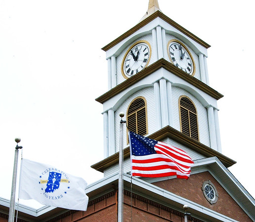 Debbie Blank | The Herald-Tribune<br /> The state bicentennial and American flags fly at the Ripley County Courthouse in Versailles.