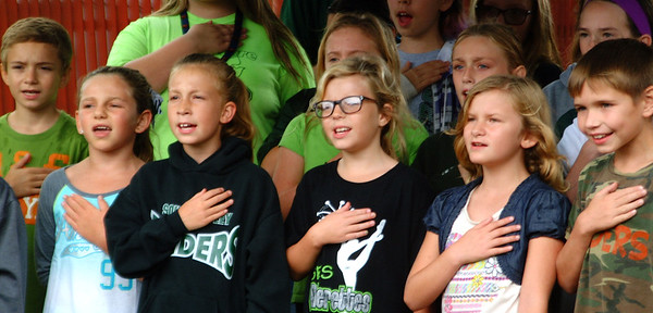 Debbie Blank | The Herald-Tribune<br /> South Ripley fourth- through sixth-graders sang the Pledge of Allegiance during the Indiana Bicentennial Torch Relay ceremony in Versailles Saturday, Sept. 17.