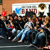 "Debbie Blank | The Herald-Tribune<br /> Waiting for the torch relay to arrive, the Jac-Cen-Del High School band played ""Don't Stop Believing"" and other hits."