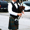 Debbie Blank | The Herald-Tribune<br /> A bagpiper added some pomp and poignant music to the procession entering Versailles.