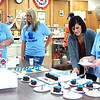 Photo courtesy of Carla Hacker<br /> Julie Brock (from left) and Morgan Brock, Clerk-Treasurer Chelsea Eckstein and Shirley Campbell serve refreshments for the Indiana Bicentennial celebration at the Sunman town hall Sept. 17.
