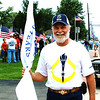 Debbie Blank | The Herald-Tribune<br /> Sunman resident John Kruse leaves that celebration to be a Dearborn County torchbearer later in the day.
