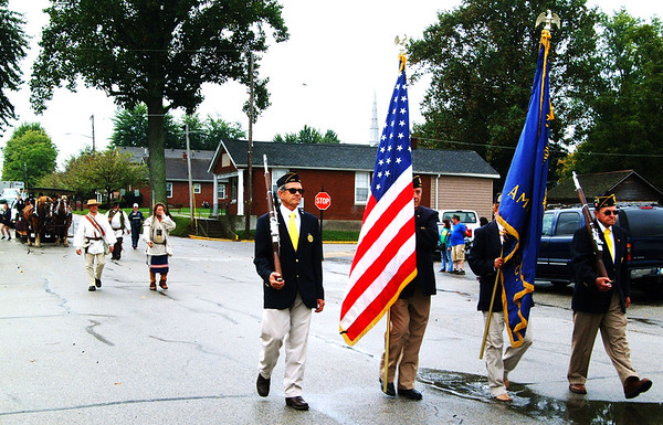 Debbie Blank | The Herald-Tribune<br /> The Versailles American Legion Post 173 honor guard led the torch relay procession into the county seat.