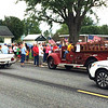 Photo courtesy of Anita Fledderman<br /> In Sunman, Kyle Brock, representing his grandpa, the late John Campbell, arrived in a 1954 Chevy Bel Air and lit the torch of Viola Bruns, representing her husband, the late Carl Bruns. She hopped on a 1938 Ford firetruck to continue south on State Road 101.