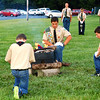 Debbie Blank | The Herald-Tribune<br /> After the Indiana Bicentennial Torch Relay Ripley County dinner, Milan Boy Scout Troop 631 conducted a somber and patriotic flag retirement ceremony.