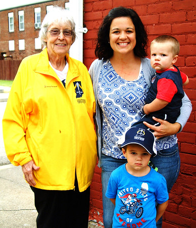 Debbie Blank | The Herald-Tribune<br /> Torchbearer Roselyn McKittrick (clockwise from left), who founded the Milan '54 Hoosiers Museum, relaxes after her relay appearance with granddaughter-in-law Michelle McKittrick and sons Grant, 1, and Easton, 3.