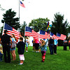 Debbie Blank | The Herald-Tribune<br /> The State Road 101 site of the Indiana Bicentennial Torch Relay Sunman stop was very patriotic with masses of American flags.