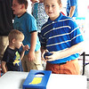 Diane Raver | The Herald-Tribune<br /> Dan Weber, 12, Sunman, enjoyed playing cornhole in the Interactive Kids Area.