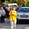 John P. Cleary | The Herald Bulletin<br /> Pendleton resident Nancy Noel carries the Indiana Bicentennial Torch Relay torch through a large crowd in Falls Park in Pendleton.