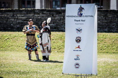 Two performers chat while getting ready for the opening of the Indigenous Arts Festival at Fort York in Toronto. June 21, 2018.