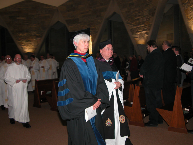 Faculty process out of the chapel.