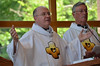 Fr. Steve welcomes everyone while Fr. Tom Cassidy, out-going provincial, looks on.