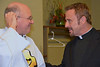 Fr. Steve receives congrats from another newly-elected provincial: Fr. Joe Rodrigues of the Salvatorians.