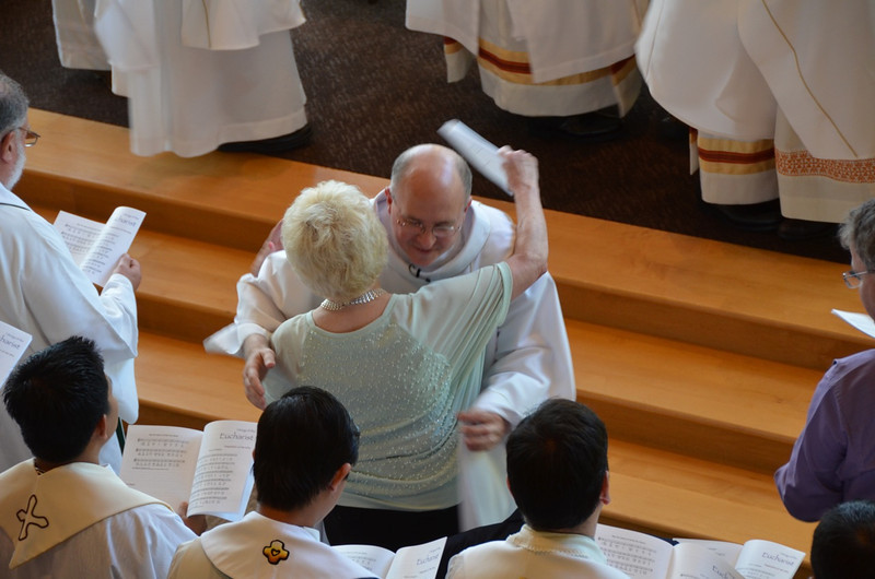 Fr. Steve shares the sign of peace with his mother.