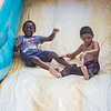 Two boys slide down the Big Kahuna to cool off during the Independence Day Celebration in Interlachen. Fran Ruchalski/Palatka Daily News