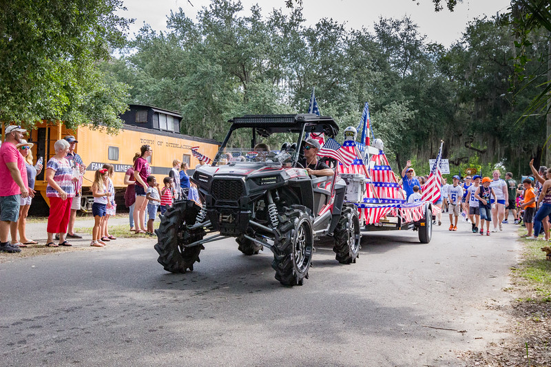 The Pop Warner sports teams marched together in the Independence Day parade through the streets of Interlachen. Fran Ruchalski/Palatka Daily News
